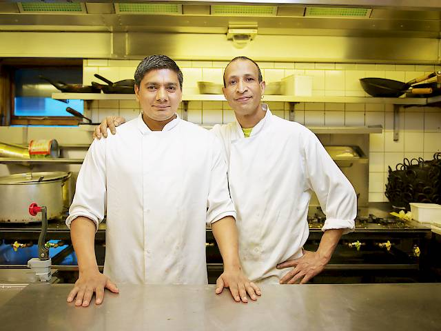 Two Viceroy chefs standing at the kitchen pass